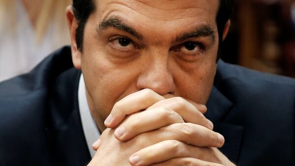 Greek Prime Minister Alexis Tsipras looks on before a ruling Syriza party parliamentary group session in Athens, Greece, May 6, 2016. - Sputnik International