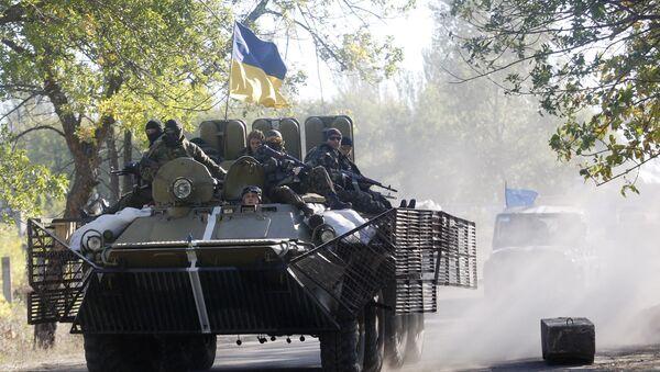 Ukrainian troops patrol in armored vehicles (File) - Sputnik International