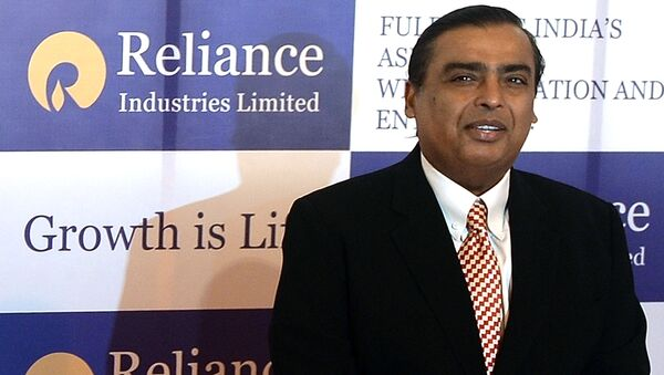 Reliance Industries Chairman Mukesh Ambani poses as he arrives for the company's annual general meeting in Mumbai on June 6, 2013 - Sputnik International