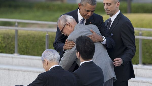 U.S. President Barack Obama hugs Shigeaki Mori, an atomic bomb survivor and a creator of the memorial for American WWII POWs killed in Hiroshima, during a ceremony at Hiroshima Peace Memorial Park in Hiroshima, western, Japan, Friday, May 27, 2016. Obama on Friday became the first sitting U.S. president to visit the site of the world's first atomic bomb attack, bringing global attention both to survivors and to his unfulfilled vision of a world without nuclear weapons. - Sputnik International