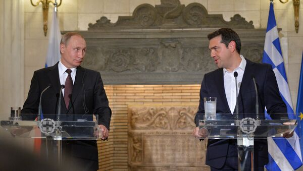 May 27, 2016. Russian President Vladimir Putin, left, and Greek Prime Minister Alexis Tsipras during a joint news conference following Russian-Greek talks in Athens. - Sputnik International