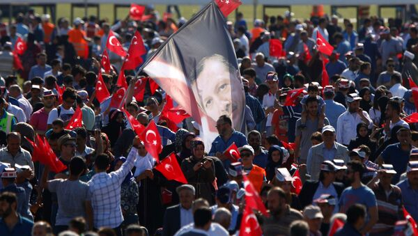 A man waves a flag with the image of Turkish President Tayyip Erdogan during a rally to mark the 563rd anniversary of the conquest of the city by Ottoman Turks, in Istanbul, Turkey, May 29, 2016. - Sputnik International