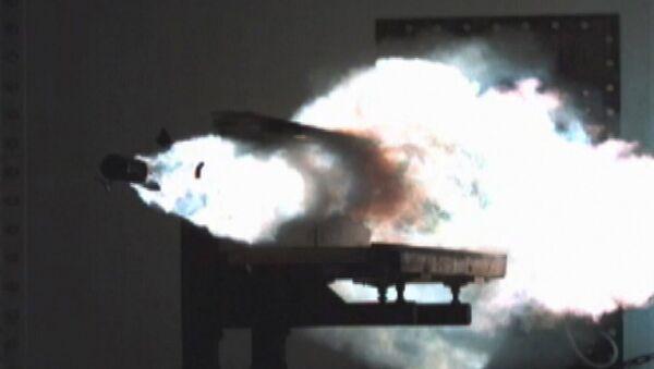 Particle debris ignites as a test slug exits the Office of Naval Research (ONR) 32 MJ (megajoules) Electromagnetic Railgun (EMRG) laboratory launcher located at the Naval Surface Warfare Center Dahlgren Division (NSWCDD) - Sputnik International