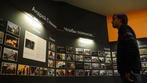Photographic exhibition of MIA Rossiya Segodnya news agency photo correspondent Andrei Stenin killed in Ukraine on professional duty. - Sputnik International