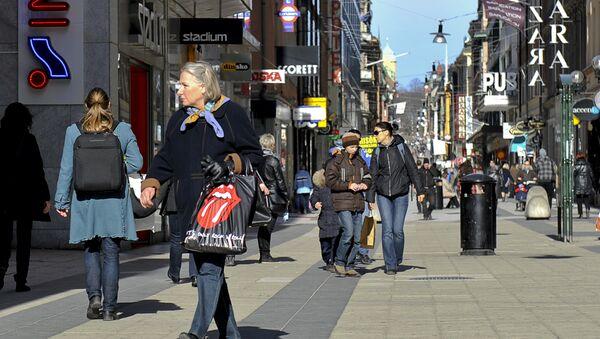 People walking on Drottninggatan Street in central Stockholm - Sputnik International