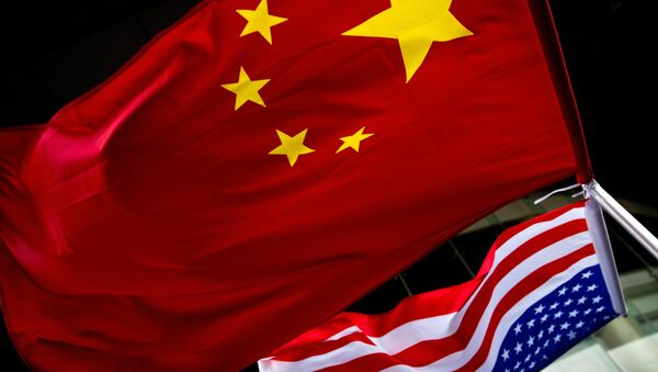 In this Nov. 7, 2012 photo, US and Chinese national flags are hung outside a hotel during the U.S. Presidential election event, organized by the US embassy in Beijing - Sputnik International