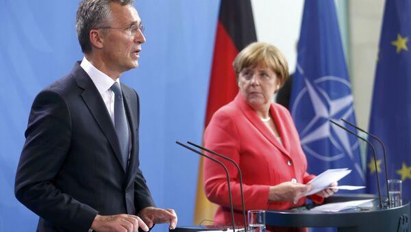 German Chancellor Angela Merkel and NATO Secretary-General Jens Stoltenberg attend a news conference following talks at the Chancellery in Berlin, Germany, June 2, 2016. - Sputnik International