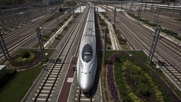 A CRH high-speed train leaves the Beijing South Station in Beijing, China, Tuesday, July 26, 2011 - Sputnik International