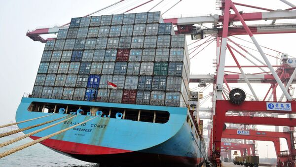 This photo taken on April 12, 2016 shows trucks transporting containers at a port in Qingdao, east China's Shandong province - Sputnik International