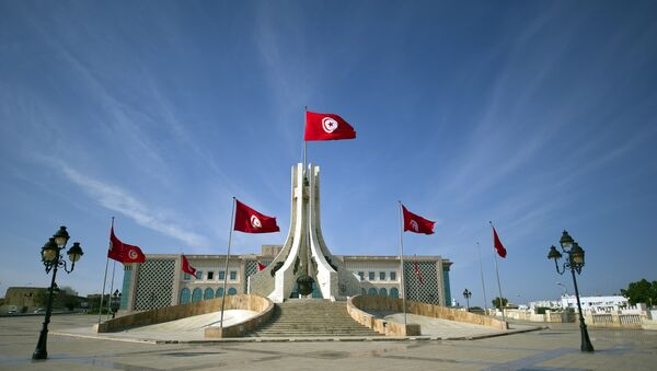 Flags of Tunisia flutter at the city hall in Tunis on October 24, 2011 - Sputnik International