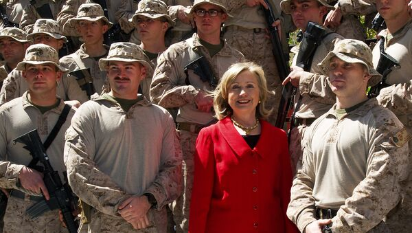 US Secretary of State Hillary Clinton poses for a photograph with members of the USMC FAST Marines, a quick response team from Norfolk, Virginia, on duty at the US Embassy in Cairo, on March 16, 2011 - Sputnik International