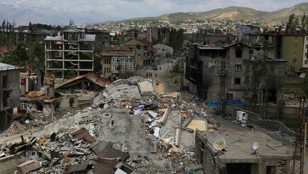 Buildings which were damaged during security operations and clashes between Turkish security forces and Kurdish militants, are seen in Yuksekova in the southeastern Hakkari province, Turkey, May 30, 2016. - Sputnik International