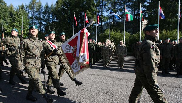 The Honorary Company of the Polish army walks in front of troops that will take part in major international Anakonda-14 defense exercise during the opening ceremony at the National Defense Academy in Warsaw-Rembertow district, Wednesday, Sept. 24, 2014 - Sputnik International