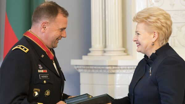 Lithuanian President Dalia Grybauskaite, right, presents the State Awards of the Republic of Lithuania, the Cross of Commander of the Order for Merits to Lithuania, to Commander of U.S. Army Europe Lt. Gen. Ben Hodges during a ceremony at the President's palace in Vilnius, Lithuania - Sputnik International