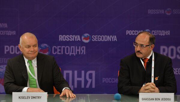 Dmitry Kiselev, left, Director General, Rossiya Segodnya International Information Agency, with Ghassan Ben Jeddou (Lebanon), Chairman of the Board of Directors, Al Mayadeen TV - Sputnik International