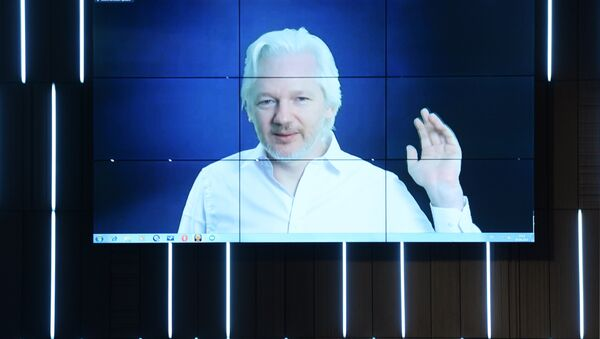 A video link up with Julian Assange, journalist, founder and editor-in-chief of WikiLeaks, at the session, End of the Monopoly: The Open Information Age, held as part of the New Era of Journalism: Farewell to Mainstream international media forum at the Rossiya Segodnya International Multimedia Press Center - Sputnik International