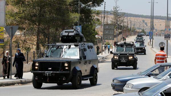 Jordanian security vehicles seen near the General Intelligence directorate offices near al Baqaa Refugee Camp, north of Amman, Jordan, June 6, 2016 - Sputnik International