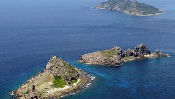 A group of disputed islands, Uotsuri island (top), Minamikojima (bottom) and Kitakojima, known as Senkaku in Japan and Diaoyu in China is seen in the East China Sea (File)  - Sputnik International