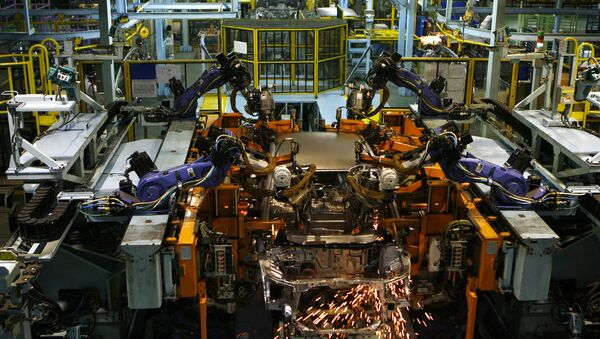 Sparks fly from a robot as it performs spot welding on a car on the production line at Honda Siel Cars India Ltd. (HSCI) factory in Noida, a satelite town on the outskirts of New Delhi on February 25, 2008 - Sputnik International