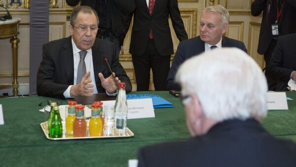 French Foreign Minister Jean-Marc Ayrault (Rear), Russian Foreign Minister Sergei Lavrov (Rear L) and German Foreign Minister Frank-Walter Steinmeier (Front) are pictured before a joint meeting on the situation in Ukraine with their Ukrainian counterpart at the French Foreign Ministry in Paris on March 3, 2016 - Sputnik International