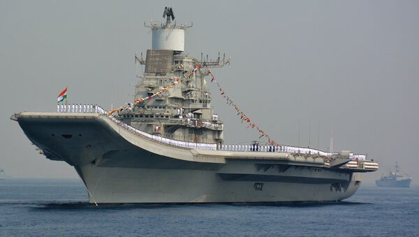 Indian Navy personnel stand on the INS Vikramaditya, a modified Kiev-class aircraft carrier, during the International Fleet Review in Visakhapatnam on February 6, 2016 - Sputnik International