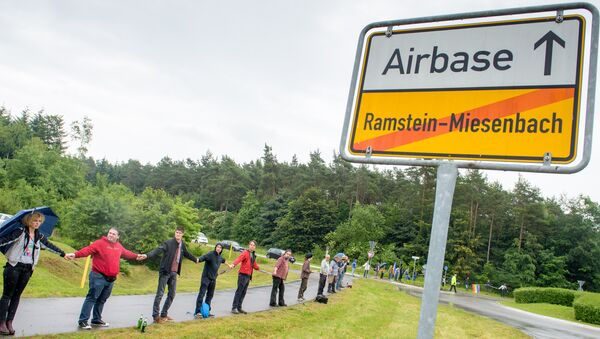 Activists attend a rally Stop-Ramstein on the road leading to US Air Force Base in Ramstein-Miesenbach on June 11, 2016 - Sputnik International