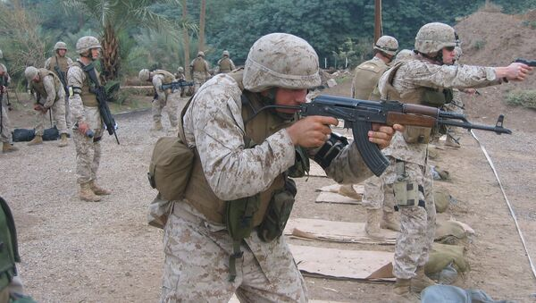 US Marine Lance Corporal Cheema firing the East German MpiKMS-72 variant of the updated version of the AK-47 assault rifle. File photo - Sputnik International