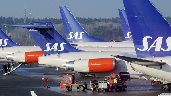 SAS aircraft are seen parked at the gates at terminal 4 of Arlanda Airport near Stockholm - Sputnik International