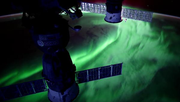 This still shows a stunning aurora captured from the International Space Station. - Sputnik International