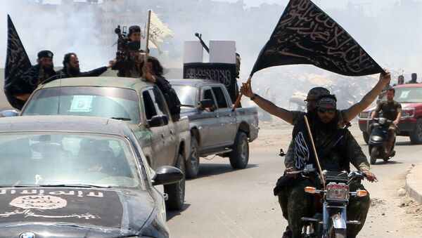 Fighters from Al-Qaeda's Syrian affiliate Al-Nusra Front - Sputnik International