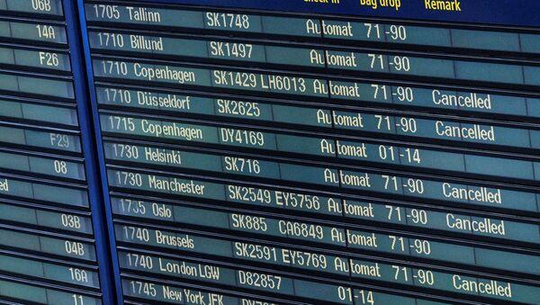 Cancelled SAS flights are seen on the information board at Arlanda airport, Sweden, June 13, 2016. - Sputnik International