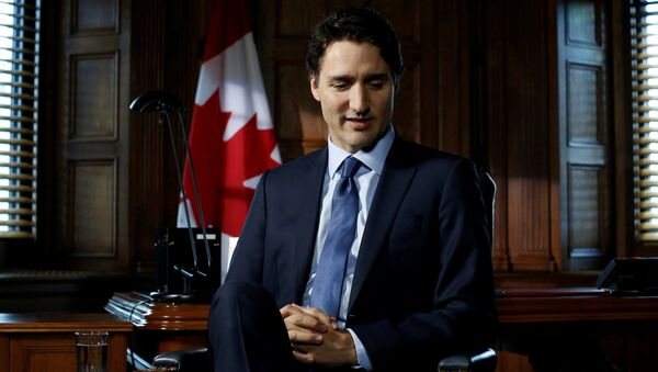 Canada's Prime Minister Justin Trudeau pauses before the start of an interview with Reuters on Parliament Hill in Ottawa, Ontario, Canada, May 19, 2016. - Sputnik International