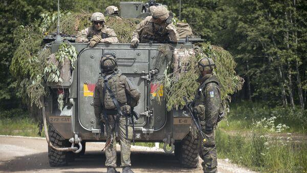 NATO troops at a range in Estonia participating in the Saber Strike-2016 exercises, June 2016. - Sputnik International