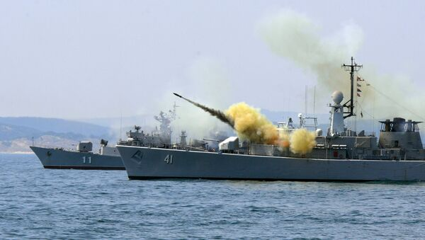 An anti-submarine rocket blasts off a rocket launcher from the Bulgarian navy frigate Drazki during the BREEZE 2014 military drill in the Black Sea on July 11, 2014 - Sputnik International