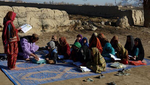 Afghan schoolchildren study at an open-air classroom in the Panjwai district of Kandahar province - Sputnik International