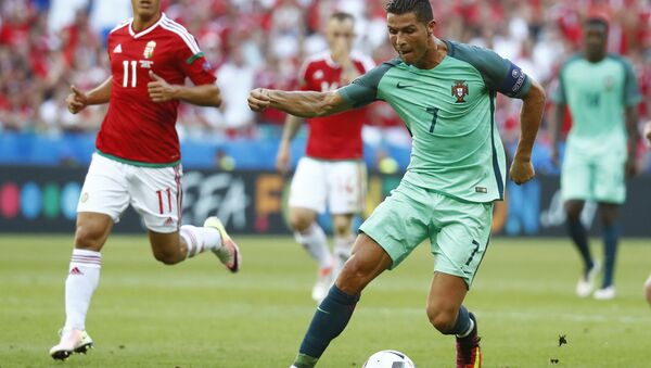 Football Soccer - Hungary v Portugal - EURO 2016 - Group F - Stade de Lyon, Lyon, France - 22/6/16 Portugal's Cristiano Ronaldo in action with Hungary's Krisztian Nemeth - Sputnik International