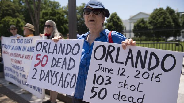 This file photo taken on June 13, 2016 shows people gather to protest gun violence and call for sensible gun laws outside the White House in Washington, D - Sputnik International