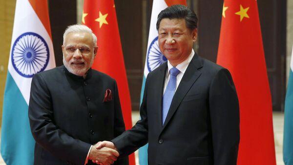 Indian Prime Minister Narendra Modi, left, and Chinese President Xi Jinping. (File) - Sputnik International