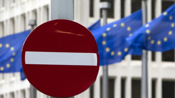 EU flags flutter in the wind in back of a no entry street sign in front of EU headquarters in Brussels on Friday, June 24, 2016. - Sputnik International