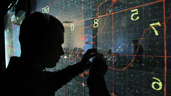 An operator by the map-board at the training command center during large-scale exercises of the Air Force and Air Defense troops - Sputnik International