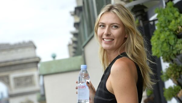 Russina tennis player and international ambassador for French mineral water company Evian, Maria Sharapova poses during a photocall prior to the start of the sporting season for the Evian brand (Tennis and Golf) in Paris on May 18, 2015 - Sputnik International