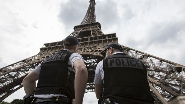 French riot police officers patrol under the Eiffel Tower, near the entrance of the soccer fan zone, prior to the Euro 2016 Group A soccer match between France and Romania, in Paris, Friday, June 10, 2016 - Sputnik International