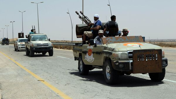 Forces loyal to Libya's UN-backed unity government patrol the entrance of Sirte as they advance to recapture the city from the Islamic State (IS) group jihadists on June 10, 2016 - Sputnik International