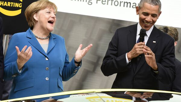 US President Barack Obama (R) and German Chancellor Angela Merkel share a laugh at the booth of Harting technology group as they tour the Hanover industrial Fair in Hanover, central Germany, on April 25, 2016 - Sputnik International