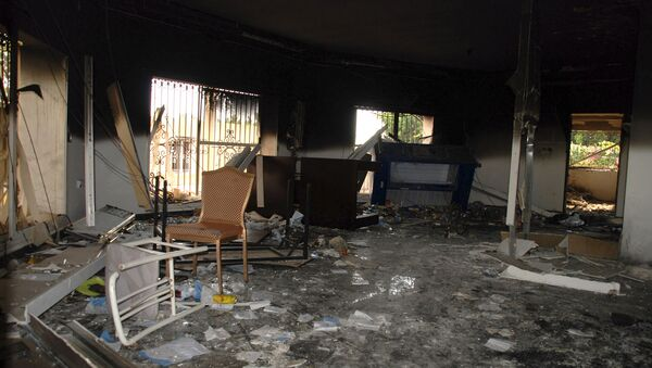 In this Sept. 12, 2012 file photo, glass, debris and overturned furniture are strewn inside a room in the gutted U.S. consulate in Benghazi, Libya, after an attack that killed four Americans, including Ambassador Chris Stevens - Sputnik International