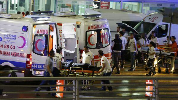 Paramedics push a stretcher at Turkey's largest airport, Istanbul Ataturk, Turkey, following a blast June 28, 2016. - Sputnik International
