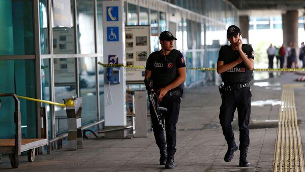 Police officers patrol at Turkey's largest airport, Istanbul Ataturk, following yesterday's blast June 29, 2016. - Sputnik International