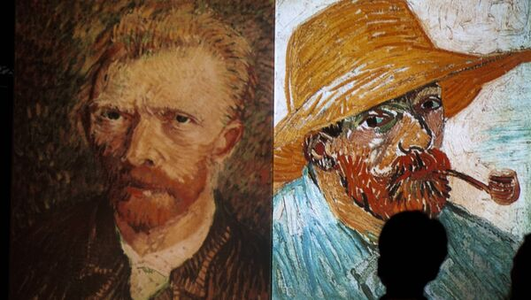 A visitor stands in front of giant screens featuring images of the work of Dutch painter Vincent van Gogh during a traveling multimedia art exhibition entitled Van Gogh alive on February 4, 2013  - Sputnik International