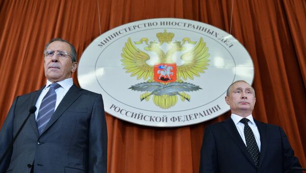 President Vladimir Putin, right, at a meeting of Russian ambassadors and permanent representatives in foreign countries held at the Foreign Ministry. Left: Russian Foreign Minister Sergei Lavrov - Sputnik International