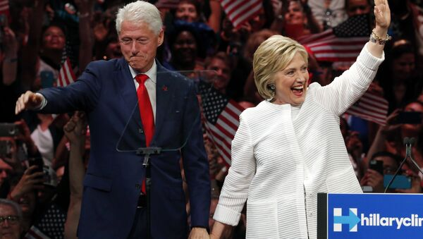 Former President Bill Clinton stands on stage with his wife, Democratic presidential candidate Hillary Clinton. - Sputnik International